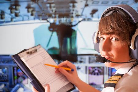daytonaaviationacademy-com-beautiful-woman-pilot-uniform-headset-notepad.jpg
